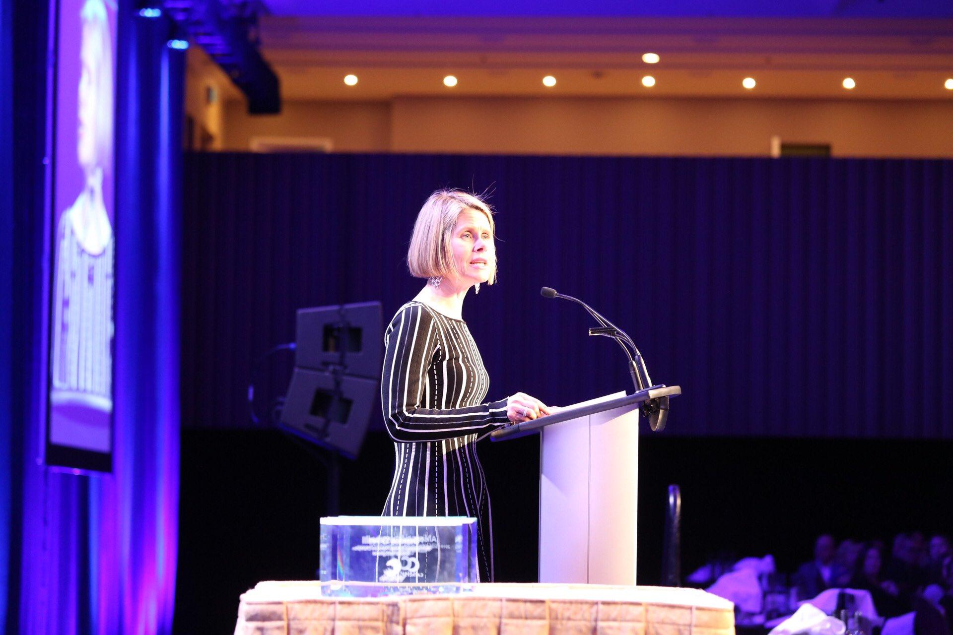 Tanya van Biesen speaking at dinner