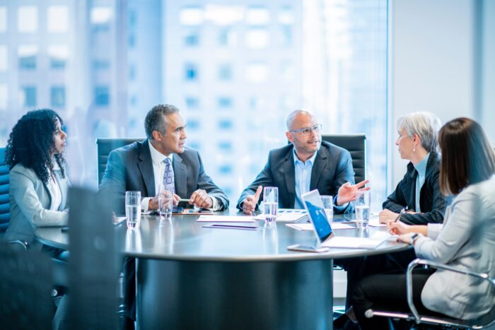 Executives in a conference room having a meeting.
