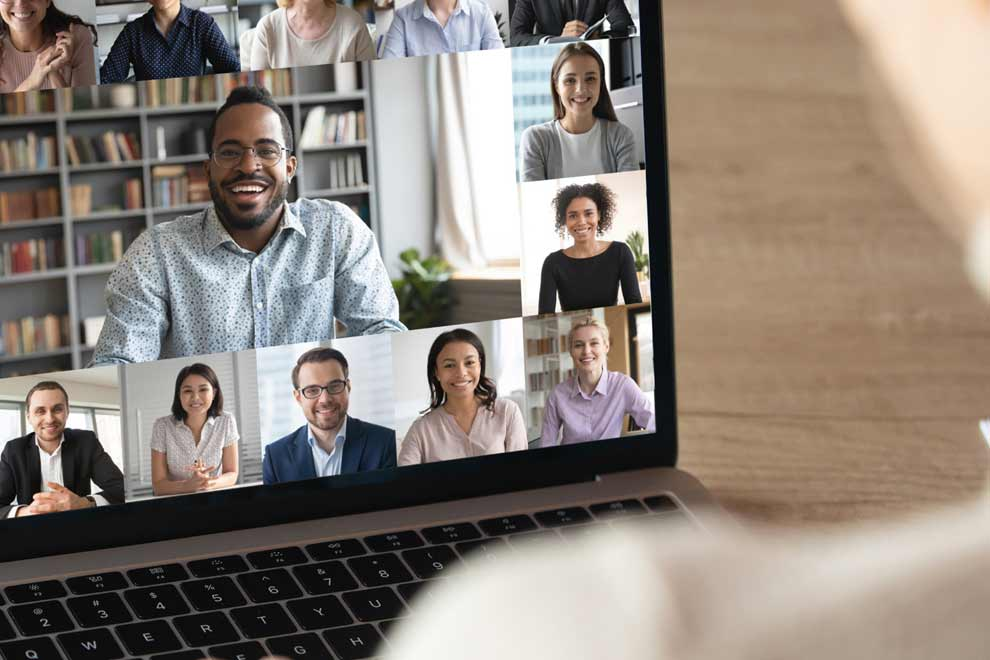 A person is looking at different faces on a laptop screen