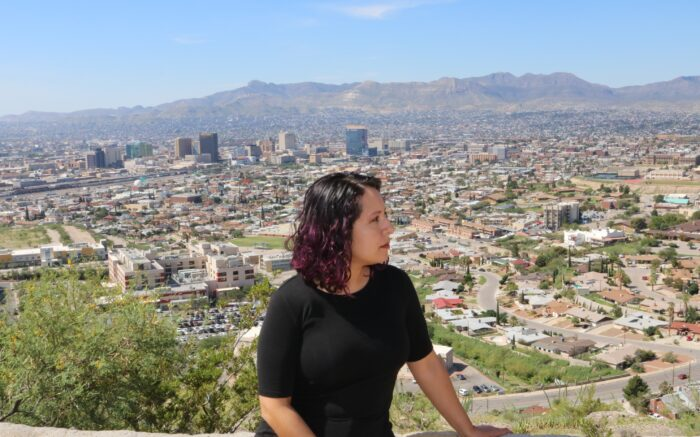 Corin Ramos in El Paso, Texas, with the border and Juarez, Mexico behind her.